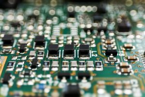 close up of printed circuit Board with chips and radio components electronics